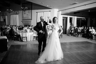 black-and-white-photo-of-father-of-the-bride-dances-with-his-daughter-in-a-winnie-couture-gown