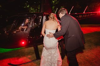 bride-in-mira-zwillenger-wedding-dress-gets-on-helicopter-with-groom-to-leave-wedding