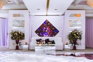 white-lounge-furniture-around-dance-floor-flower-arrangements-diamond-purple-art-and-accessories