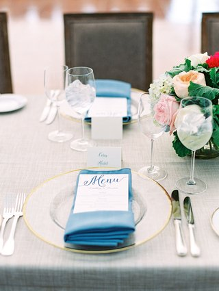 wedding-reception-gold-clear-charger-plate-rim-with-blue-napkin-menu-with-blue-calligraphy-escort