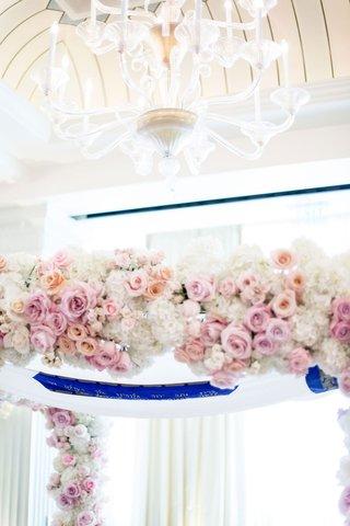 wedding-ceremony-chuppah-pink-apricot-rose-flowers-white-hydrangea-chandelier-overhead-drapery