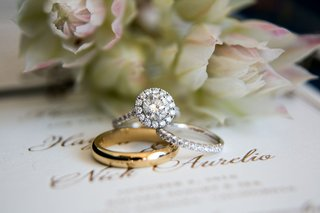 round-diamond-engagement-ring-with-halo-pave-band-and-pave-diamond-wedding-ring-mens-gold-band