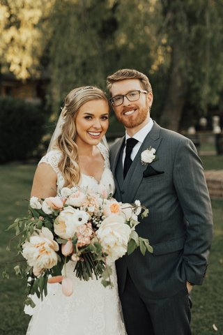 blonde-bride-in-lace-stella-york-gown-with-groom-in-three-piece-grey-suit-and-black-tie