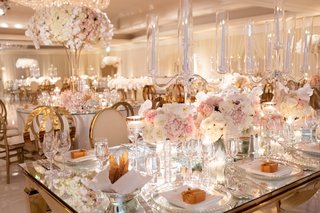 wedding-reception-mirror-table-top-with-crystal-candelabra-low-centerpiece-white-pink-rose-orchid