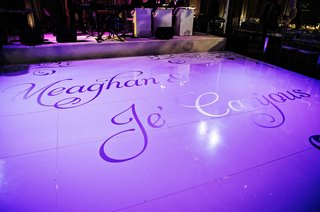 custom-dance-floor-at-wedding-reception-with-bright-purple-lighting-and-names