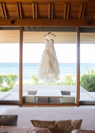 asymmetrical-wedding-dress-hanging-in-turks-and-caicos-resort