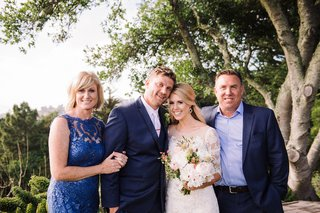 bride-and-groom-with-mother-and-father-of-bride-in-forest