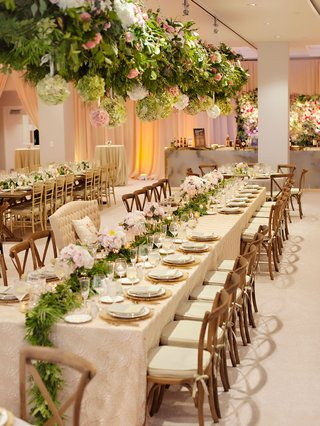 rustic-wedding-ceremony-greenery-runner-and-chandeliers-with-hydrangea-balls-and-greenery-overhead