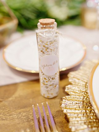 wedding-reception-favors-sprinkles-in-glass-bottle-with-cork-to-throw-at-couple-during-grand-exit