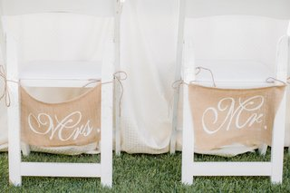 outdoor-wedding-reception-with-white-chairs-and-burlap-mrs-and-mr-signs