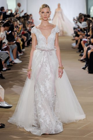 ines-di-santo-fall-2019-bridal-collection-wedding-dress-fae-lace-trumpet-v-neck-ribbon-overskirt