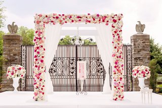 wedding-ceremony-decor-white-four-post-ceremony-structure-pink-and-ivory-flowers-outdoor-ceremony
