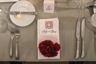 wedding-place-setting-with-red-peony-on-napkin-wrapped-menu