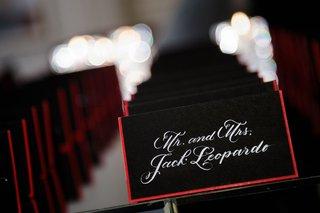 elizabeth-grace-chicago-wedding-escort-cards-black-stationery-red-border-white-calligraphy