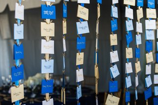 gold-and-blue-seating-card-assignments-on-ribbon