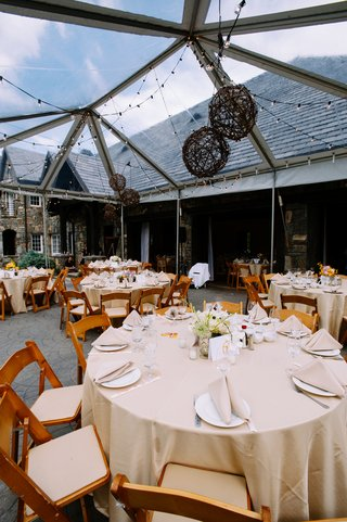reception-tent-with-string-lights-and-wicker-lanterns