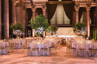 ballroom-wedding-with-tree-centerpieces-and-gold-chairs
