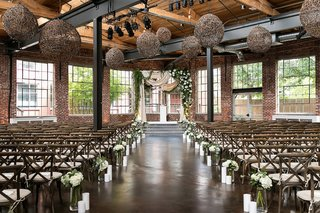 the-foundry-at-puritan-mill-wedding-dark-wooden-brick-ceremony-space-vineyard-chairs