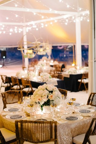 gold-sequin-linen-tablecloth-with-wood-chair-island-wedding-tent-in-the-bahamas-flower-centerpiece