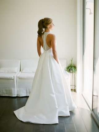 bridal-ponytail-modern-trousseau-oxford-inverted-box-pleat-pockets-lace-racerback