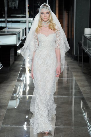 a-re-embroidered-lace-gown-with-an-embroidered-cape-sleeve-and-bodice-detail-by-reem-acra