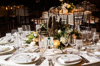 wedding-reception-round-table-small-wood-stump-in-center-surrounded-by-candles