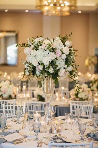 wedding-reception-hotel-ballroom-tall-white-hydrangea-pink-rose-centerpiece-blue-glassware-goblet