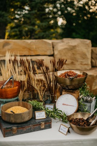 wedding-reception-outdoor-garden-wedding-ideas-fall-late-summer-hammer-wood-bronze-bowls-calligraphy