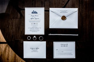formal-wedding-invitation-with-blue-print-bronze-wax-seal-photographed-with-diamond-jewelry