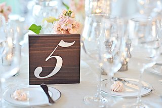 number-5-five-on-wooden-block-table-number