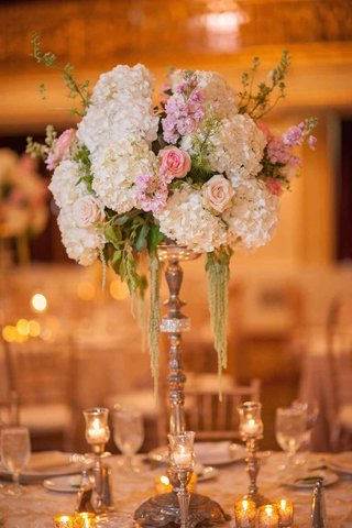 wedding-reception-table-with-high-gilded-stand-white-hydrangeas-pink-and-peach-roses-amaranthus