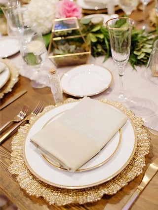 wedding-reception-wood-table-linen-runner-gold-charger-plate-terrarium-sprinkles-champagne-flute