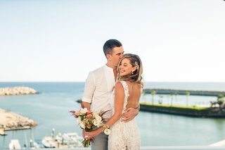 bride-with-backless-lace-dress-casual-groom-destination-wedding-in-cabo-san-lucas