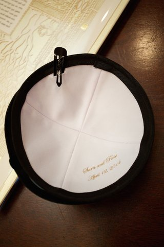 black-yarmulke-with-white-interior-and-name-of-bride-and-groom-wedding-date-for-jewish-wedding