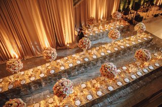 wedding-reception-overhead-view-tall-centerpieces-drapery-uplighting-gold-linens-place-setting-model