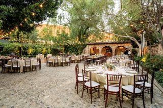 outdoor-wedding-reception-at-hummingbird-nest-ranch-courtyard-reception-bistro-lights