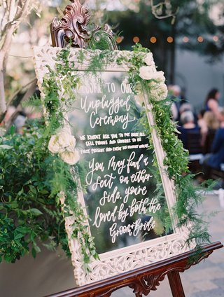 wedding-ceremony-outdoor-vibiana-white-frame-mirror-greenery-unplugged-ceremony-calligraphy-signage
