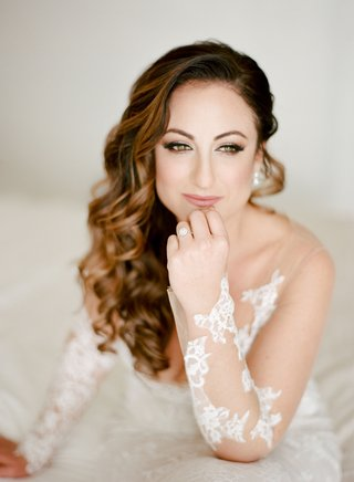 bride-in-ines-di-santo-wedding-dress-long-curly-brown-hair-swept-to-side-over-crown-pretty-makeup