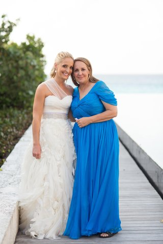 bride-with-mother-of-bride-in-blue-dress-on-pier