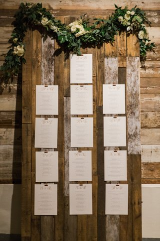 cards-on-wooden-board-with-green-garland