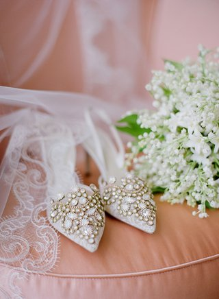 wedding-shoes-jewel-design-on-blush-cushion-with-veil-and-lily-of-the-valley-bouquet