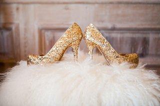 gold-glitter-wedding-shoes-on-faux-fur-pouf