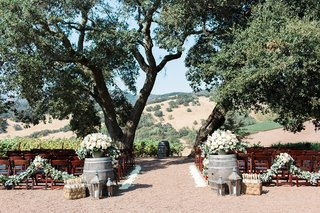 outdoor-rustic-winery-ceremony-space-northern-california-sonoma-wedding-wine-barrels-natural-trees