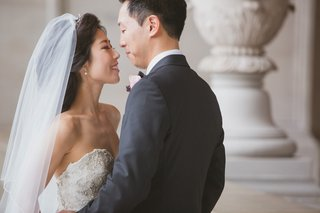 korean-bride-in-kenneth-pool-strapless-wedding-dress-and-groom-on-wedding-day