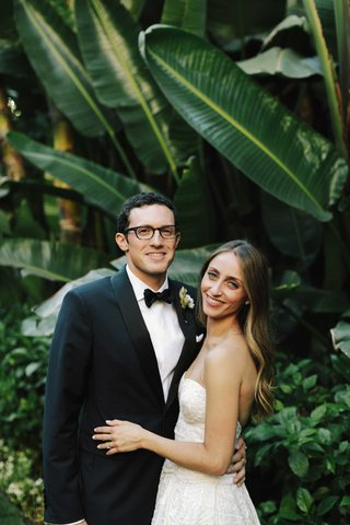 wedding-couples-groom-in-glasses-and-bow-tie-tuxedo-bride-in-strapless-wedding-dress-long-hair-down