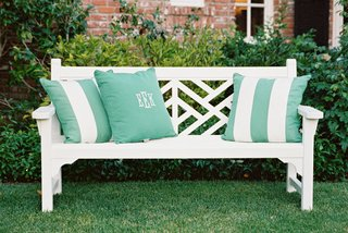 white-lounge-furniture-with-green-and-white-stripe-pillows-and-monogram-pillow
