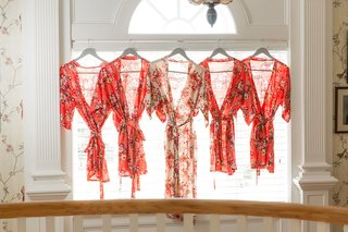 brides-long-robe-and-bridesmaids-getting-ready-robes-red-pink-peach-style-flower-robe