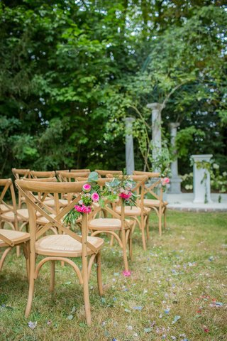 wedding-ceremony-chairs-wood-x-back-vineyard-chairs-decorated-with-greenery-pink-flowers