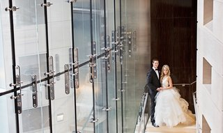 bride-in-vera-wang-wedding-dress-with-groom-in-tuxedo-before-wedding-at-rooftop-terrace-for-theater