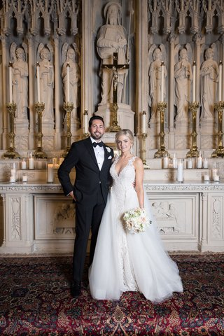 bride-and-groom-portrait-at-catholic-church-wedding-ceremony-chicago-lace-gown-overskirt